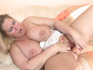 Busty blonde floosie flashes her big boobs with the addition of plays with her pussy