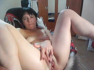 busty mature woman fingering the brush pussy with lovense masturbater
