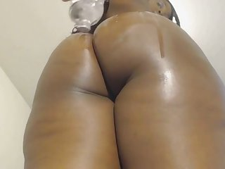Oiled up ebony shakes her big booty superior to before webcam and loves it