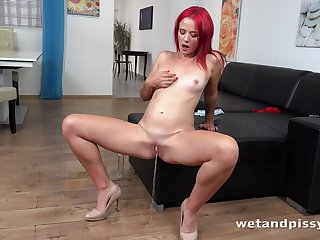 Red-hot haired pissing prostitute Tiffany Reverence is enthusiastic to masturbate her wet pussy