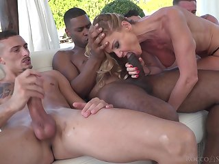 MILF sucks a bunch of dicks before trying them all